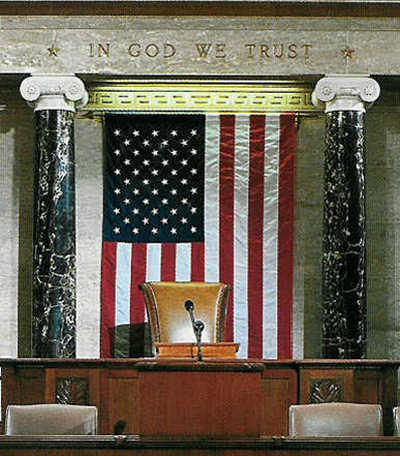 "National Motto of the U.S., ""In God We Trust,"" engraved above the Speaker's Chair in the House of Representatives Chamber of the U.S. Capitol Building in Washington D.C."