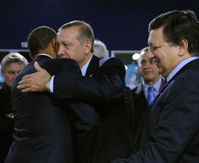 President Obama gives Islamist Turkish Prime Minister Erdogan a hug at the G-20 Summit in Cannes, France. European Leaders only got handshakes.